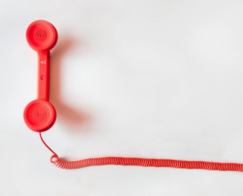 Photo of red telephone receiver. WriteCulture Blog